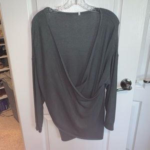 chunky knit gray-green sweater with low swoop